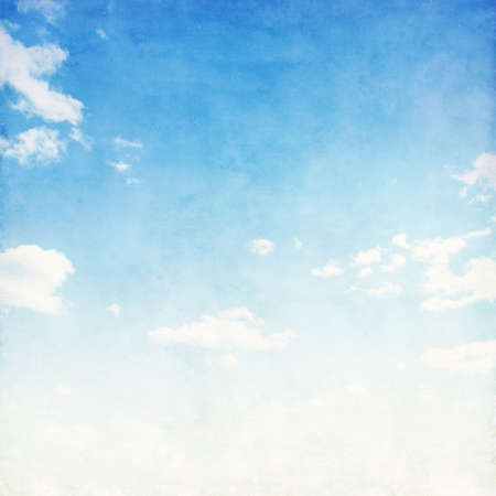 Blue sky with sparse clouds in grunge style