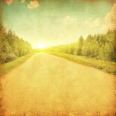 tar paper: Rural road running through the forest at sunset in grunge and retro style  Stock Photo