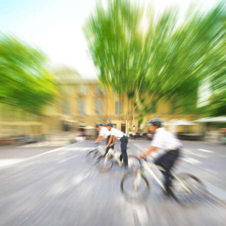 Police officers on bicycles in motion blur  photo