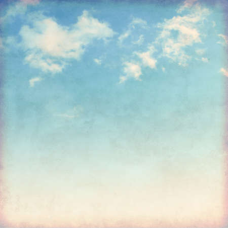 vintage background pattern: White clouds in blue sky in grunge and retro style.