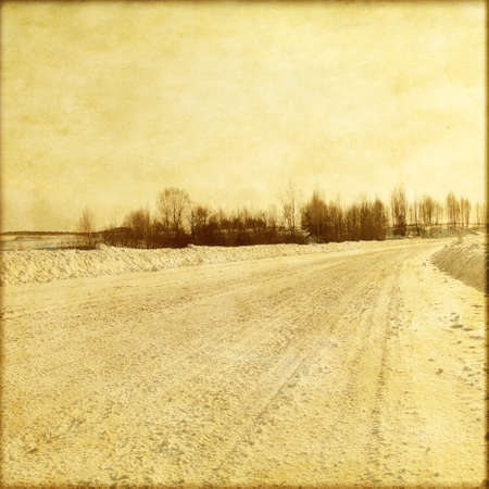 Old style photo of winter country road  photo