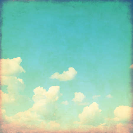 blue toned: Grunge image of blue sky with clouds.