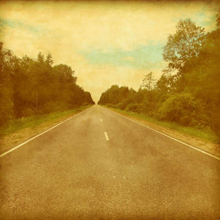 Grunge style image of country asphalt road. photo