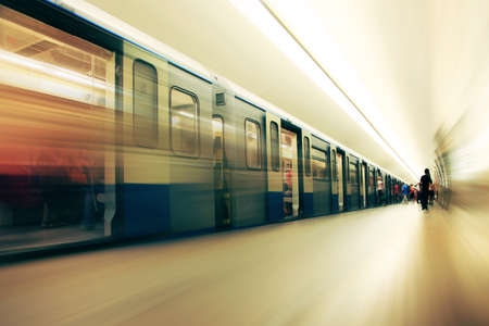 Motion blurred commuters walking in subway station. Stock Photo