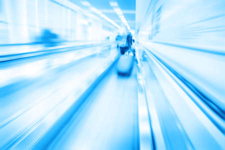 Abstract image of moving walkway and blurred people on background. photo