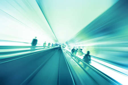 Abstract image of moving walkway and blurred people. photo