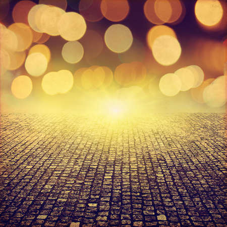 yellow stone: Stone pathway and abstract bokeh lights in grunge style. Stock Photo