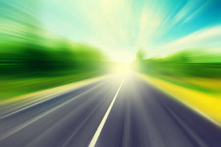 Image of asphalt road in motion blur at moody day.