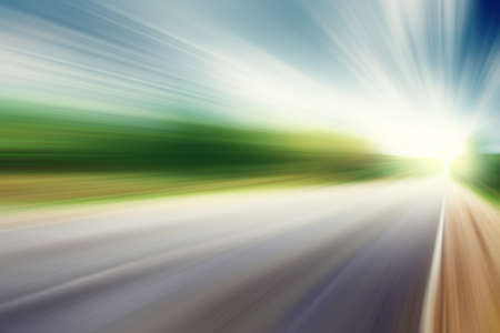 Image of asphalt road in motion blur at moody day   Stock Photo