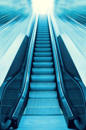 Toned image of escalator and light on background   photo