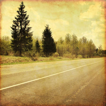 tar paper: Country asphalt road in grunge and retro style.