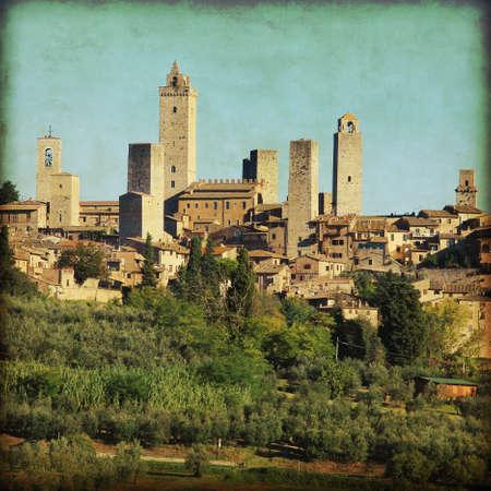 italian village: View of San Gimignano in grunge and retro style. Tuscany. Italy. Stock Photo
