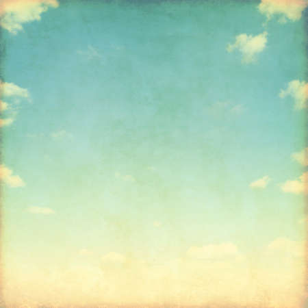retro grunge: Blue sky with white clouds in grunge style.