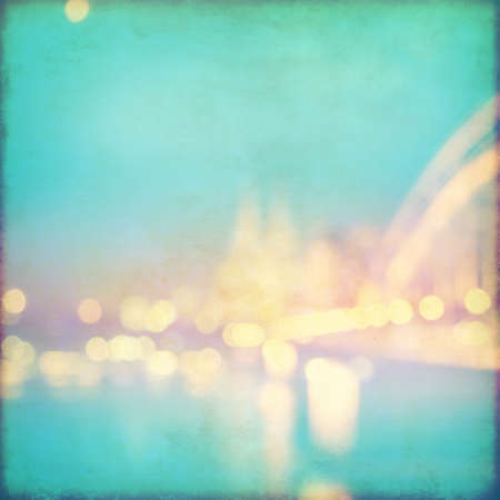 water stained: Abstract blurred cityscape background with bokeh effect. Grunge and retro style.