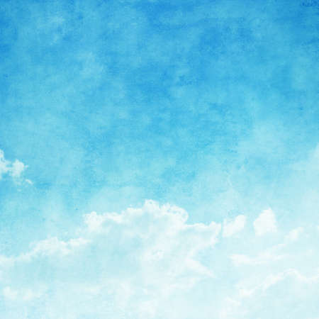 blue vintage background: Blue sky with white clouds in grunge style.