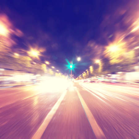 speed line: Abstract motion blurred image of night traffic in the city.