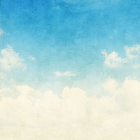 backgrounds grungy dots: Blue sky with white clouds in grunge style.