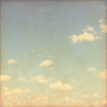 sparse: Blue sky with sparse clouds in grunge style.
