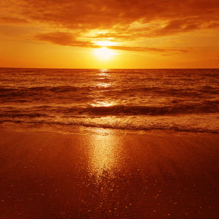 over the sea: Dramatic red sunset over the sea. Stock Photo