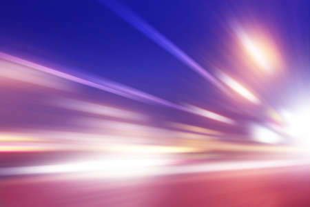 Traffic lights in motion blur on the road at night. Stock Photo