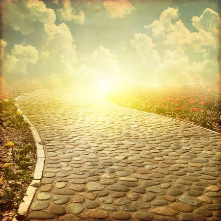 Stone pathway at sunset. Grunge and retro style. Stock Photo