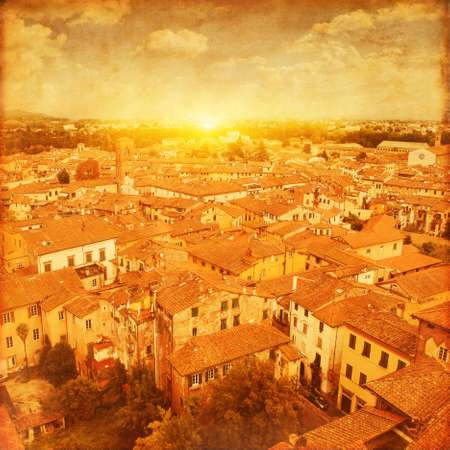 Grunge image of Lucca at sunset, old town in Tuscany. Italy. Stock Photo
