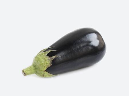 Aubergine isolated on grey background. Eggplant close up photo.