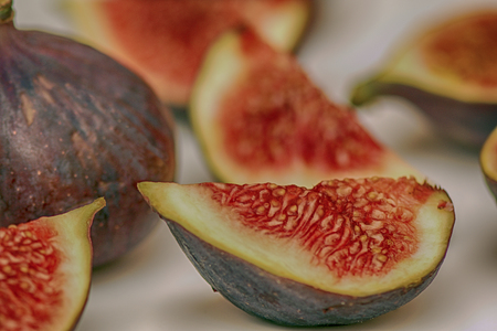 delicious and juicy figs sliced on white background
