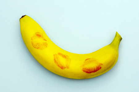 minimalism, banana in lipstick from kisses symbolizing sex,one