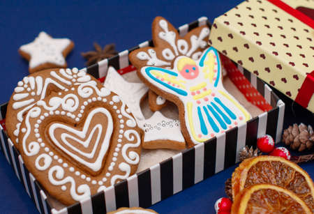Handmade Christmas gingerbread cookies. Cozy atmosphere. A mood of magic and wonder. The concept of a new year.
