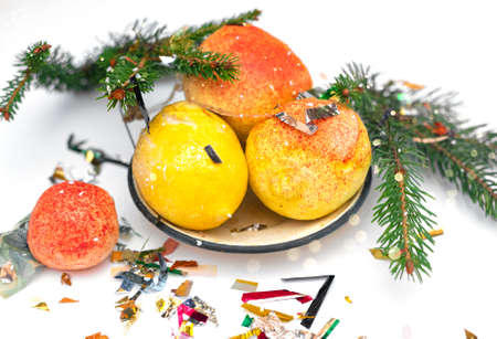 Retro vintage Soviet new year fruit made of cotton wool and paper in an old iron plate.