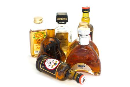 Mini bottle of alcohol on white background. Finland