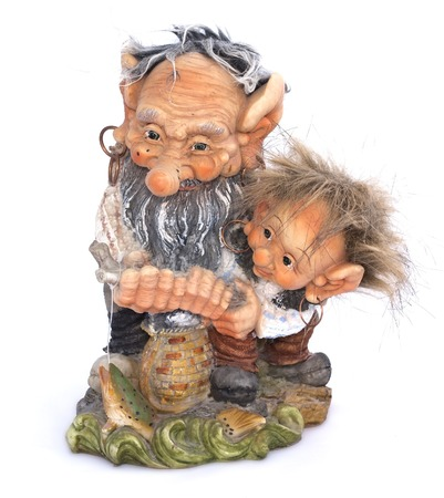 fisher: Two fisher troll with fishing rod figurine on a white background Stock Photo