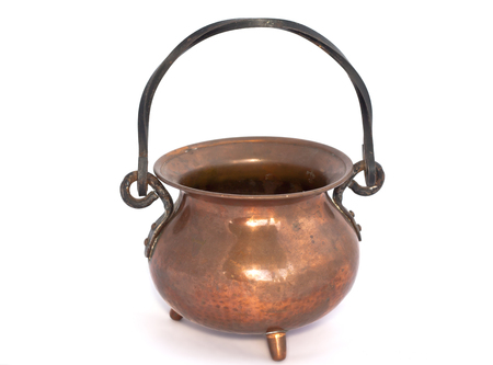Old copper pot on a white background Stock Photo