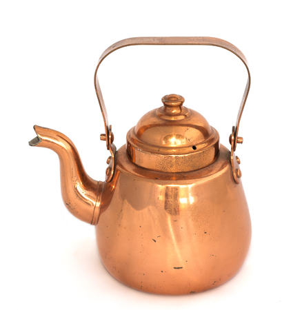 Old copper kettle on a white background