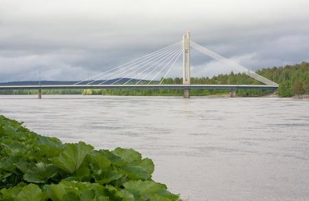 rovaniemi: Candle of rafts man bridge in Rovaniemi at cloudy evening, Finland