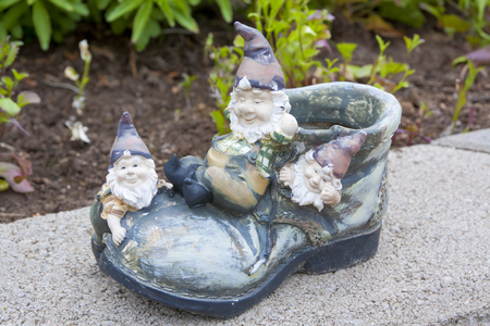 Funny garden gnomes sitting on the shoe Stock Photo