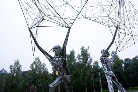 onega: Sculpture Fishermen on sky background, Petrozavodsk, Waterfront Stock Photo