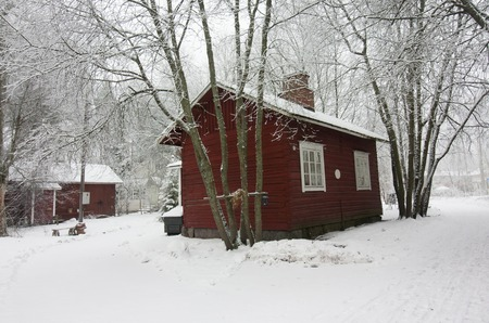 snowed: Colorful wooden houses snowed in Finland at winter Stock Photo