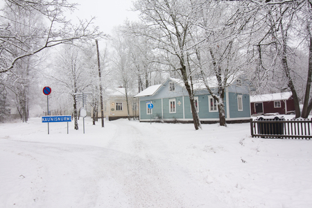 winter finland: Colorful wooden houses snowed in Finland at winter Stock Photo