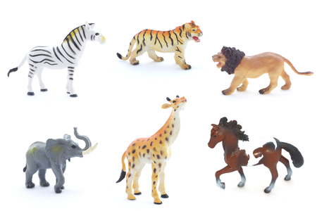 Collage of toy animals isolated on white background. 版權商用圖片