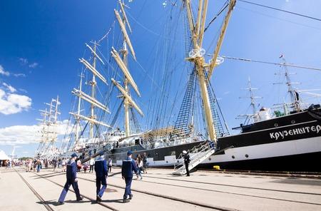 navy blue background: Barque Kruzenshtern and sailors in the port of Kotka, Finland. THE TALL SHIPS RACES KOTKA 2017. Kotka, Finland 16.07.2017.