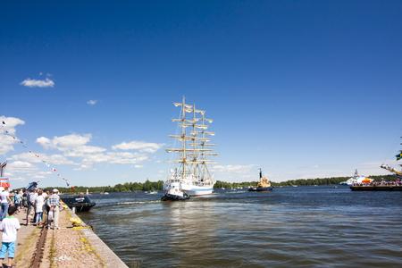 navy blue background: THE TALL SHIPS RACES KOTKA 2017. Kotka, Finland 16.07.2017. Ship Mir is leaving the port of Kotka, Finland