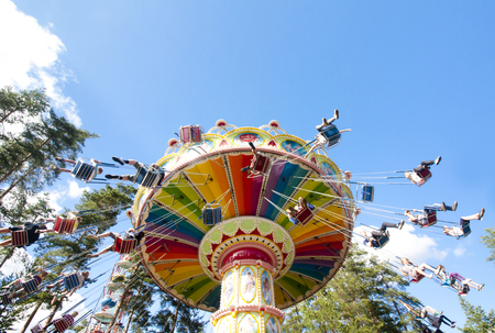Colorful chain swing carousel in motion at amusement park on blue sky background Stock Photo - 83004455