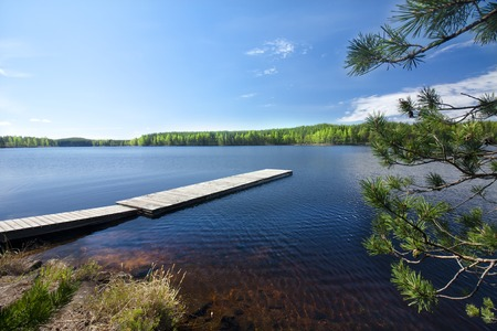 Wooden pier on beautiful lake in the national park Repovesi, Finland, South Karelia