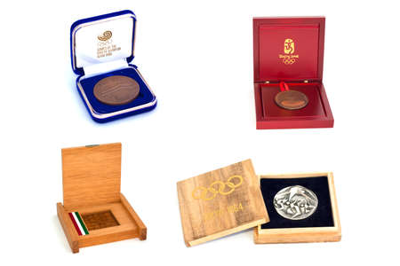 Collection of Summer Olympic Games Participation medals reverse and obverse in boxes. Tokyo 1964, Mexico 1968, Seoul 1988, Beijing 2008. Kouvola Finland 12032017 에디토리얼