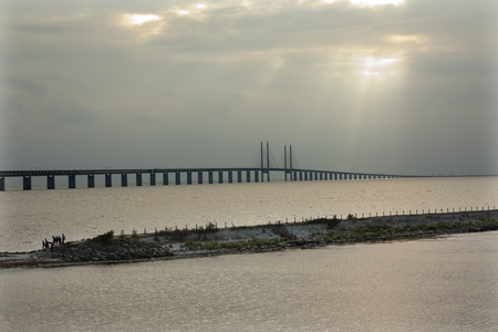 Oresund Bridge on sunset, between Sweden and Denmark, Malmo