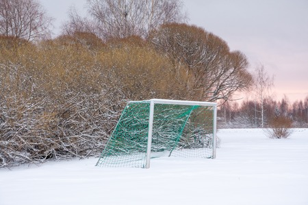 Soccer goal outdoor at the winter day