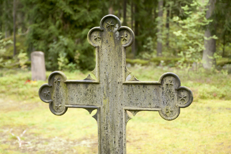 Cross at old beautiful semetery in Finland