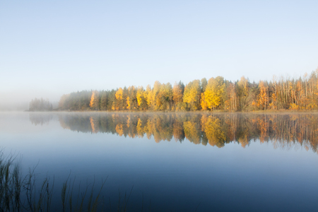 Beautiful autumn morning landscape of Kymijoki river waters in fog. Finland, Kymenlaakso, Kouvola